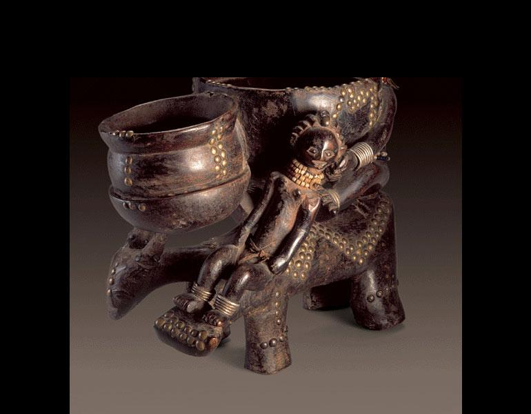 Bowl bearer. Luba, D.R.C. Wood, brass tacks, iron, beads; h. 39 cm. Felix Collection. Photo: © Dick Beaulieux, Brussels