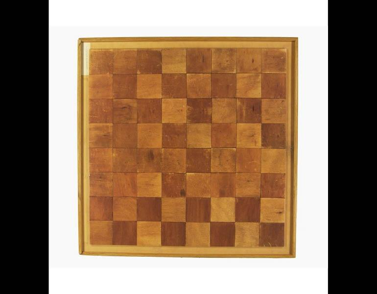 "Marcel Duchamp is a wooden box, described as Duchamp's ""mental"" chessboard and used to depict his life-long love of the game and as subject matter for some of his important art pieces."