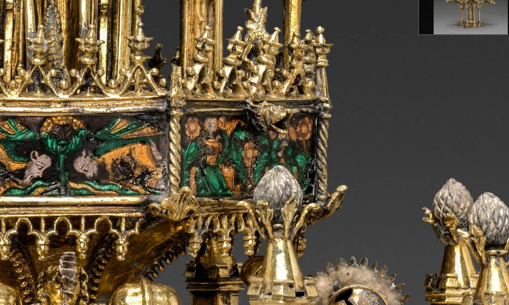 detail of an ornate gold medieval table fountain